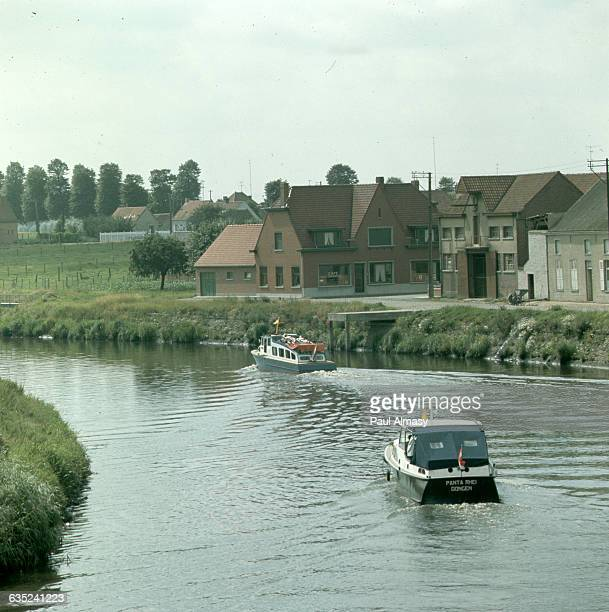 The Scheldt river is an important waterway for both drainage and commerce in Belgium. Here it flows past Quievrain, the last Belgian town before the...