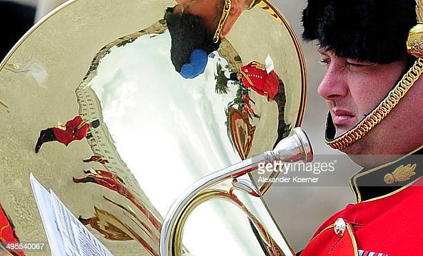 The Schloss Herrenhausen is reflected on the pipe of a member of The Band Of The Corps Of Royal Engineers during the arrival of Prince Andrew the...