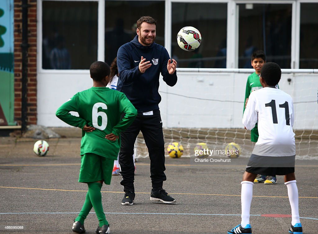 The school children take part in activities during the Premier League Players Kit Scheme Launch at Allen Edward Primary School on March 17, 2015 in London, England.