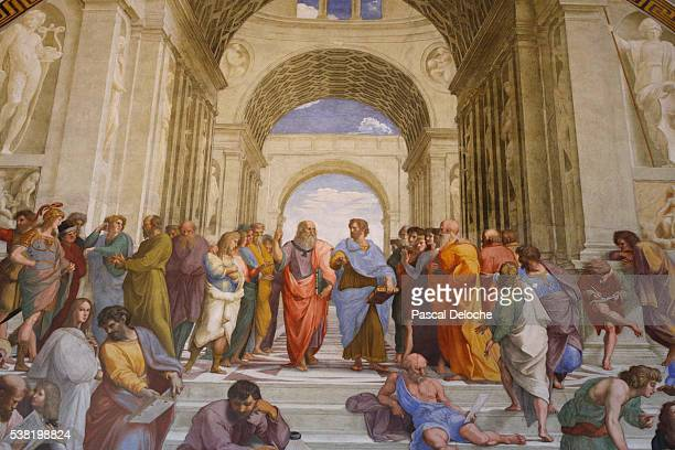 the school of athens. detail of a mural by raphael painted for pope julius ii - in the center plato (leonardo da vinci) discourses with aristotle. 1509. raphaël. room of the segnatura. vatican museum. - school of athens stock pictures, royalty-free photos & images