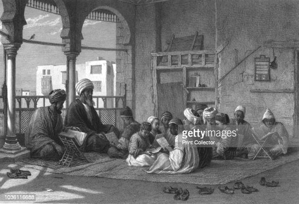 The School of Sooltan Hassan' circa 1869 Boys seated on a carpet studying with teachers using books on wooden stands Thought to be Sultan Hassan's...