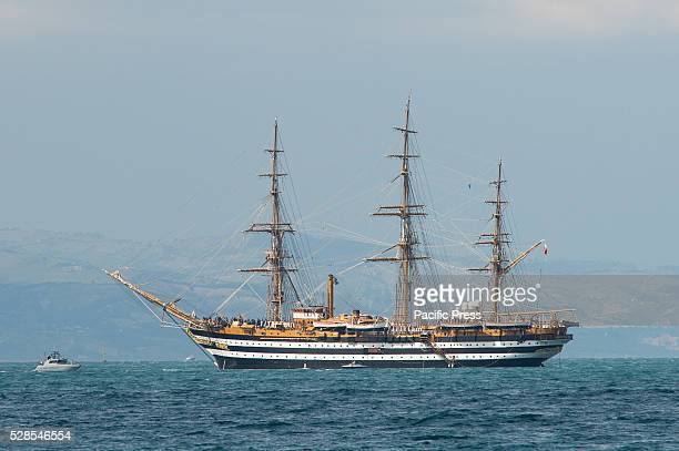 The school ship Amerigo Vespucci in the harbor of Corigliano escorted by the aircraft carrier Cavour during his first voyage after long storage due...