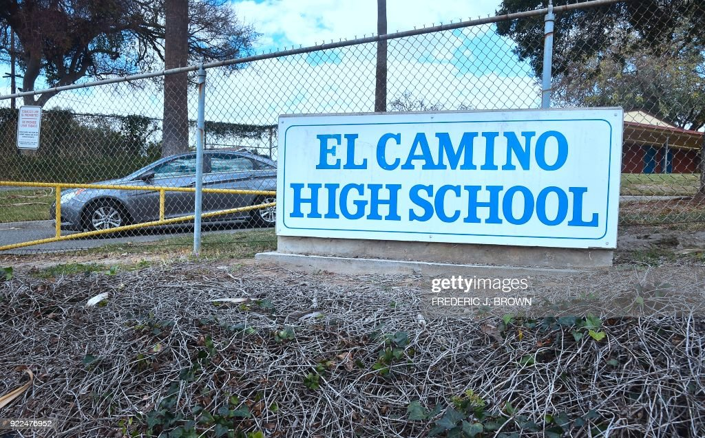 The school sign in front of El Camino High School in Whittier, California on February 21, 2018 where a threat by a student overheard by a school safety officer may have stopped a shooting. Authorities were alerted, leading to the finding of a cache of weapons in the teenager's home. Marino Chavez, a security officer at El Camino High School in Whittier, southeast of Los Angeles, helped thwart a potential shooting February 16, 2018, two days after the deadly Valentines Day shooting in Florida that left 17 people dead, authorities said February 21. Chavez said during a news conference he overheard a 17-year-old student say he was going to launch an attack within three weeks. Chavez stopped and questioned the student, who claimed it was a joke, he said. / AFP PHOTO / Frederic J. BROWN