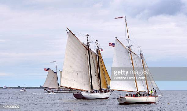 The schooners Eastwind Spirit of Massachusetts and Harvey Gamage right to left sail around Boothbay Harbor on Wednesday June 27 2012 as part of the...