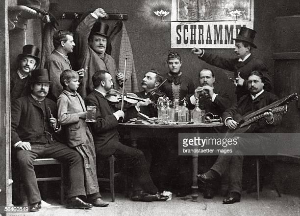 The Schrammel quartet at a wine tavern in Vienna The brothers Johann and Joseph Schrammel with violines guitarist Anton Strohmayer and clarinetist...