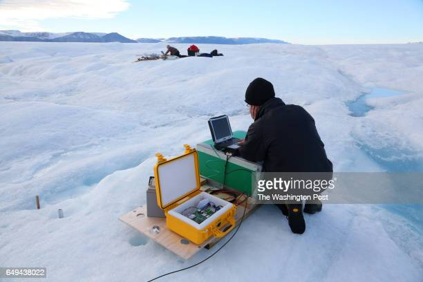 The scientists Andreas Muenchow left in the distance and Keith Nicholls right work on Petermann glacier on August 27 2016 The data stations the...