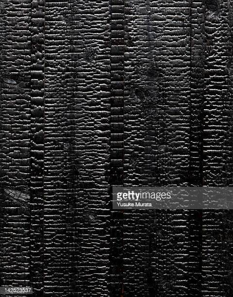 the scorched charred wooden plank - burnt stock pictures, royalty-free photos & images