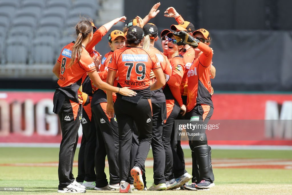 The Scorchers celebrate after defeating the Thunder during the Women's Big Bash League match between the Sydney Thunder and the Perth Scorchers at Optus Stadium on February 1, 2018 in Perth, Australia.