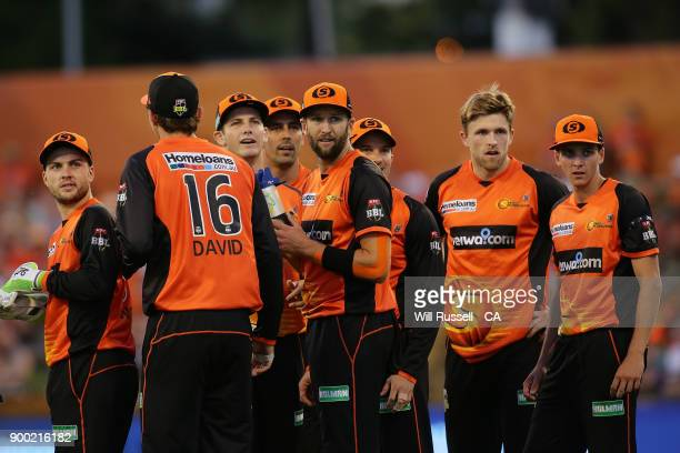The Scorchers look to the replay screren after Andrew Tye takes a catch to dismiss Nic Maddinson of the Sixers during the Big Bash League match...