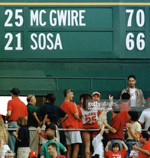 The score board at Busch Stadium in St Louis MO 27 September reflects the two home run day of St Louis Cardinal first baseman Mark McGwire against...