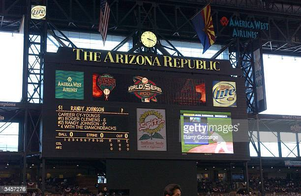 The score board displays statistics about Randy Johnson of the Arizona Diamondbacks during the Opening Day game against the Colorado Rockies at Bank...