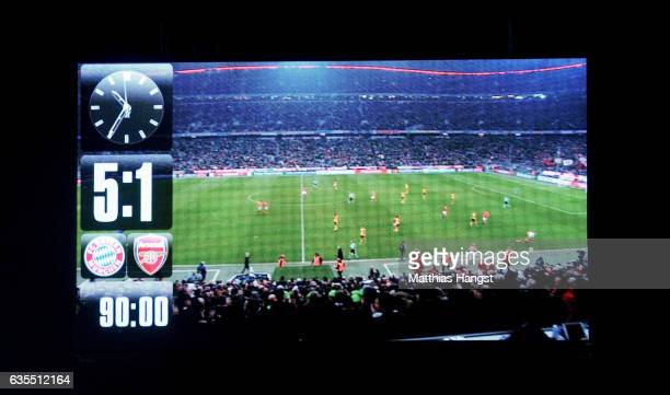 The score board is pictured after the UEFA Champions League Round of 16 first leg match between FC Bayern Muenchen and Arsenal FC at Allianz Arena on...