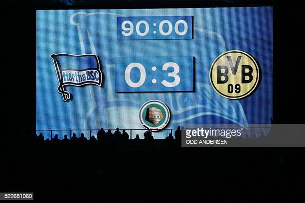 The score board shows the 03 result of the the German Cup semifinal football match Hertha Berlin v Borussia Dortmund at the Olympic stadium in Berlin...