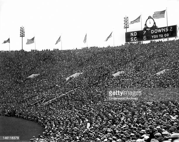 The scoreboard and crowd at halftime during the Notre Dame-USC football game at Soldiers Field, Chicago, Illinois, November 26, 1927. The Fighting...