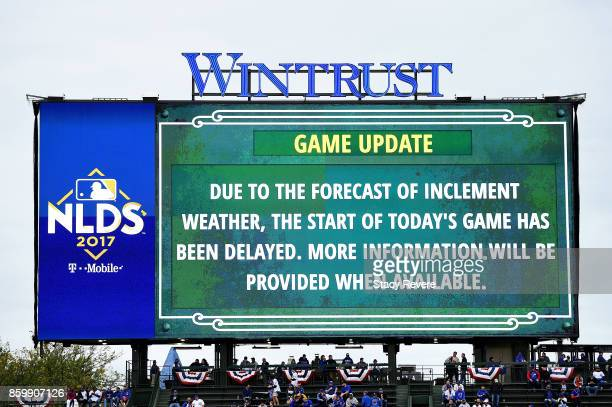 The scoreboard announces a weather delay before game four of the National League Division Series between the Washington Nationals and the Chicago...