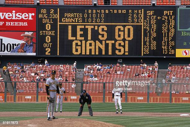 The scoreboard at Candlestick Park says, 'Let's Go Giants!' during the fifth inning of a baseball game between the San Francisco Giants and the...