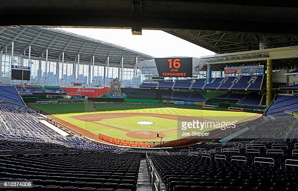 The scoreboard at Marlins Park displays the name and number of pitcher Jose Fernanedez who died in a boating accident as play was cancelled between...