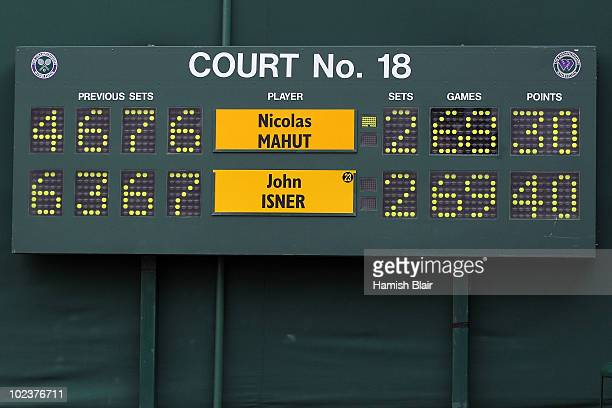 The scoreboard at match point during the 3 day long John Isner of USA v Nicolas Mahut of France first round match on Day Four of the Wimbledon Lawn...