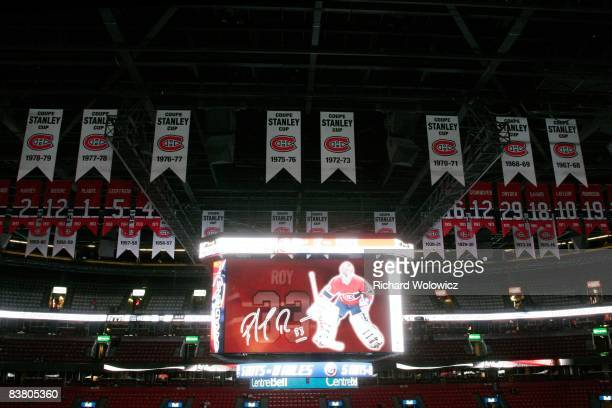 The scoreboard at the Bell Centre displays images of Patrick Roy with Stanley Cup banners and retired numbers in the background before the game...
