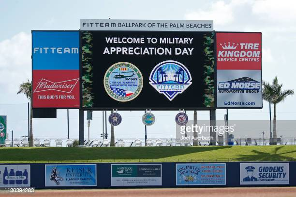 The scoreboard at The Fitteam Ballpark of the Palm Beaches displays a sign showing that today is Military Appreciation Day, prior to the spring...