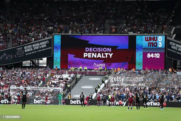The scoreboard at the London Stadium after VAR decides that Manchester City's saved penalty is to be retaken during the Premier League match between...