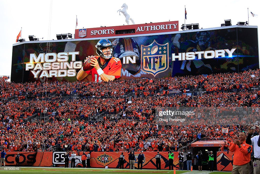 The scoreboard commemorates the occation as quarterback Peyton Manning #18 of the Denver Broncos sets the NFL career passing yards record with a four yard completion to Ronnie Hillman #23 of the Denver Broncos against the Kansas City Chiefs in the first quarter at Sports Authority Field at Mile High on November 15, 2015 in Denver, Colorado. Mannning passes Bret Farve who previously held the record at 71, 838 yards.