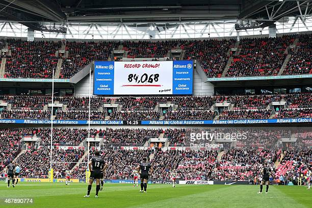The Scoreboard denotes a record crowd attendance for a club match during the Aviva Premiership match between Saracens and Harlequins at Wembley...