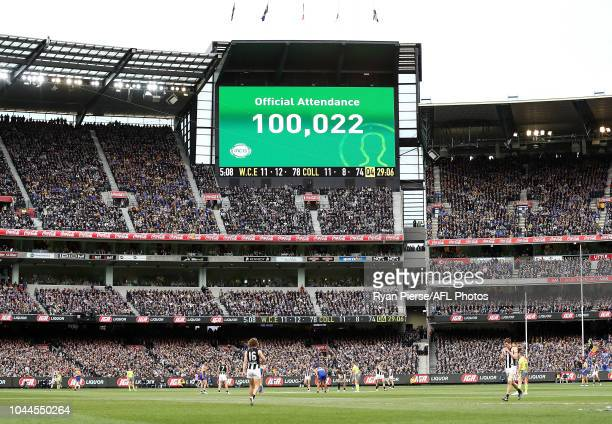The scoreboard displays a crowd of 100021 people during the 2018 AFL Grand Final match between the Collingwood Magpies and the West Coast Eagles at...
