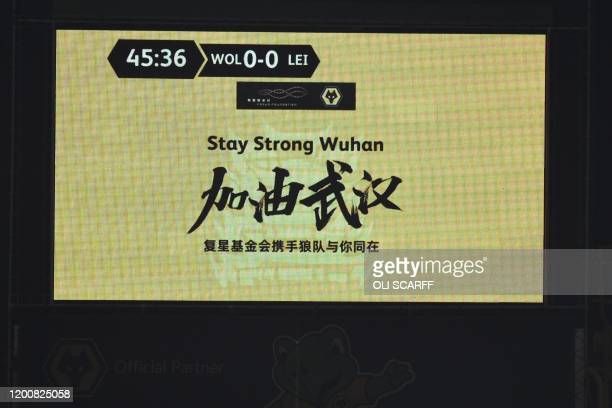 The scoreboard displays a message for support for the people of Wuhan during the English Premier League football match between Wolverhampton...