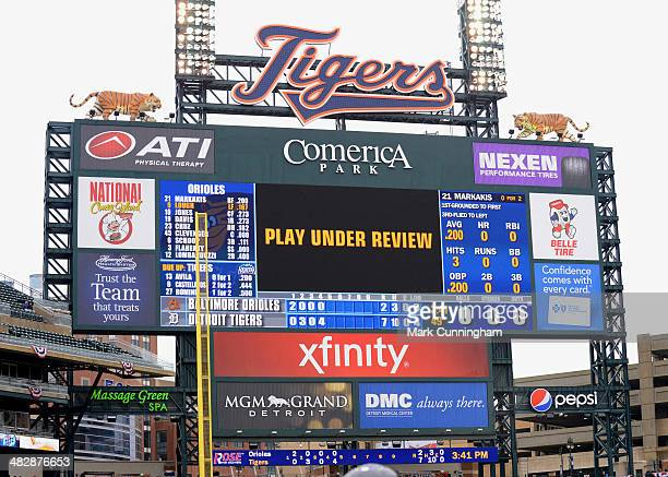 The scoreboard displays a message that the previous play is under instant replay review during the game between the Baltimore Orioles and the Detroit...