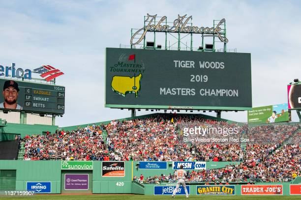 The scoreboard displays that Tiger Woods has won the Masters golf tournament during a game between the Boston Red Sox and the Baltimore Orioles on...