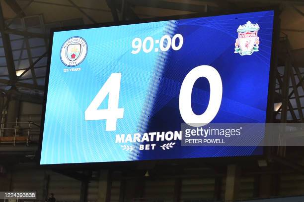 The scoreboard displays the 40 scoreline after 90 minutes during the English Premier League football match between Manchester City and Liverpool at...