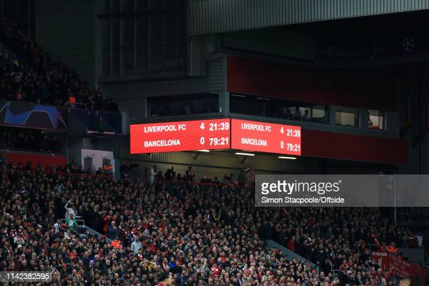 The scoreboard displays the 4-0 scoreline towards the end of the UEFA Champions League Semi Final second leg match between Liverpool and FC Barcelona...