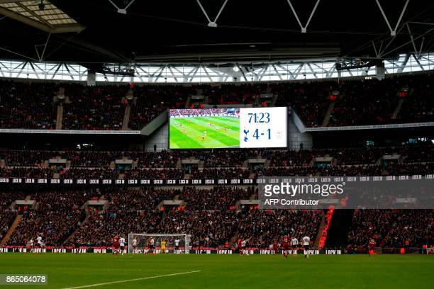 The scoreboard displays the 41 scoreline as the game enters the final stages during the English Premier League football match between Tottenham...