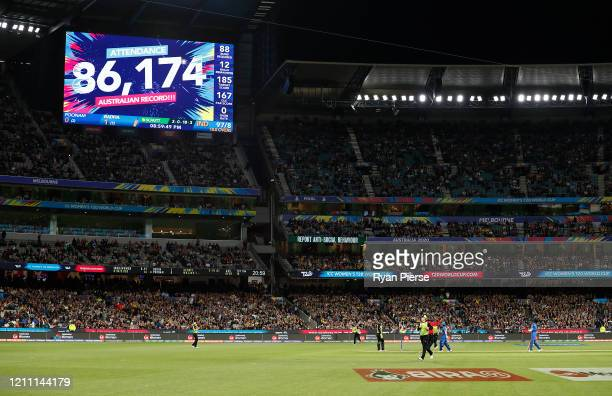The scoreboard displays the crowd attendance during the ICC Women's T20 Cricket World Cup Final match between India and Australia at the Melbourne...