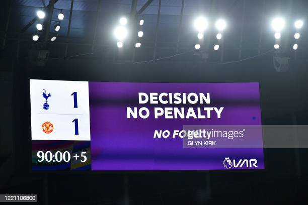 The scoreboard displays the decision by VAR that a potential second penalty for Manchester United is disallowed during the English Premier League...
