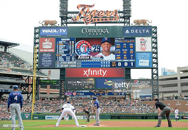 The scoreboard displays the picture and stats of Adrian Beltre of the Texas Rangers as he bats in the first inning of the game against the Detroit...