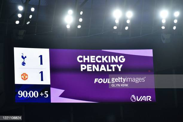 The scoreboard displays the review by VAR into a potential second penalty for Manchester United, subsequently disallowed during the English Premier...