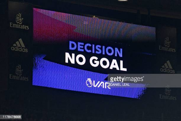 The scoreboard displays the VAR decision disallowing Arsenal's third goal by Arsenal's Greek defender Sokratis Papastathopoulos during the English...
