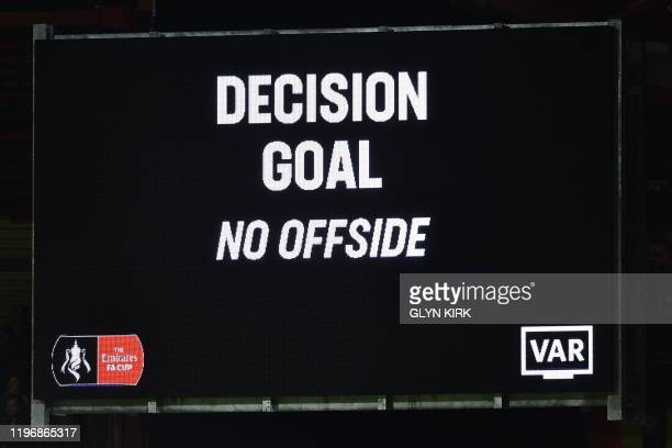The scoreboard displays the VAR decision of a goal after a review for a possible offside in the build-up to Arsenal's second goal during the English...
