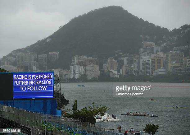 The scoreboard highlights the postponement of the rowing events due to bad weather conditions on Day 5 of the Rio 2016 Olympic Games at Lagoa Stadium...