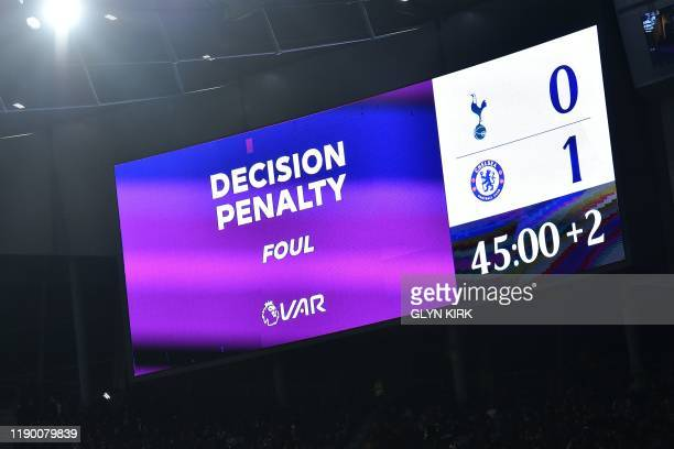 The scoreboard indicates the penalty decision after a VAR review during the English Premier League football match between Tottenham Hotspur and...