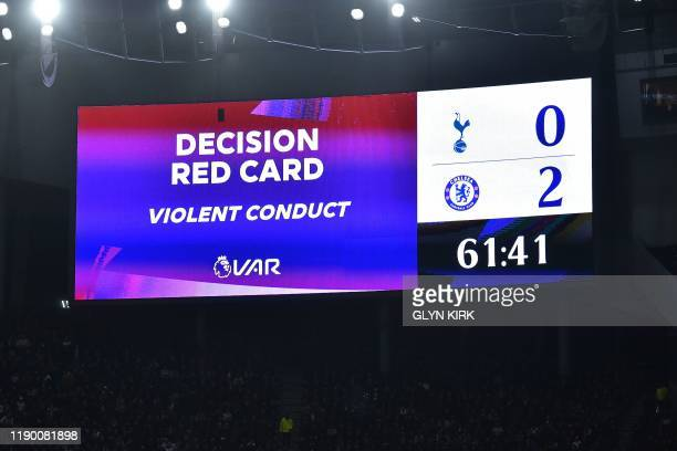 The scoreboard indicates the red card decision after a VAR review meaning Tottenham Hotspur's South Korean striker Son Heung-Min is sent off during...