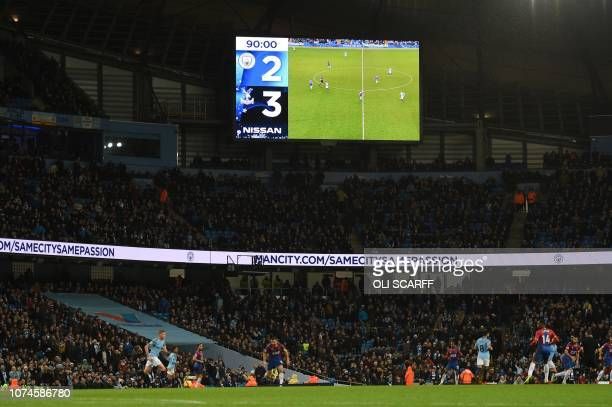 The scoreboard is seen during the English Premier League football match between Manchester City and Crystal Palace at the Etihad Stadium in...