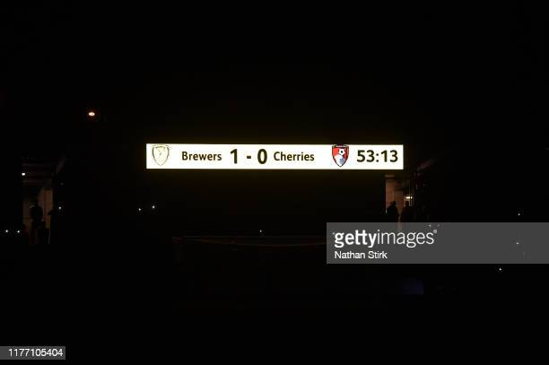 The scoreboard is seen inside the stadium as the floodlights stop working during the Carabao Cup Third Round match between Burton Albion and AFC...