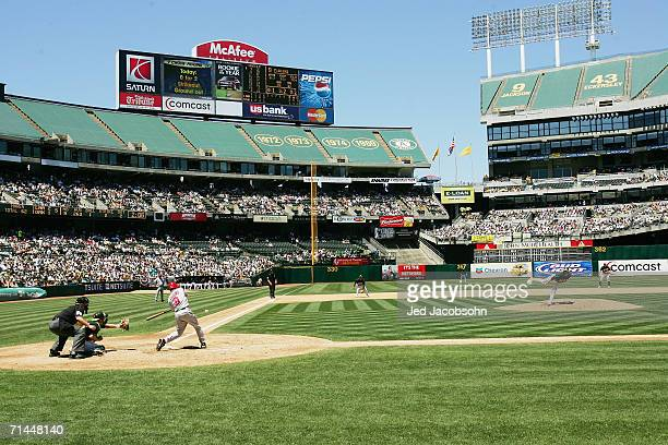 The scoreboard is shown in the background as Dan Haren of the Oakland Athletics pitches to Chone Figgins of the Los Angeles Angels of Anaheim at...