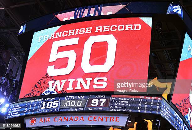 The scoreboard marks the 50 win of the season for the Toronto Raptors a franchise record following an NBA game against the Atlanta Hawks at the Air...