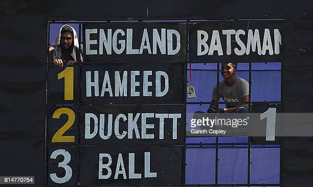 The scoreboard operators watch play during a tour match between a Bangladesh Cricket Board XI and England at MA Aziz stadium on October 15 2016 in...