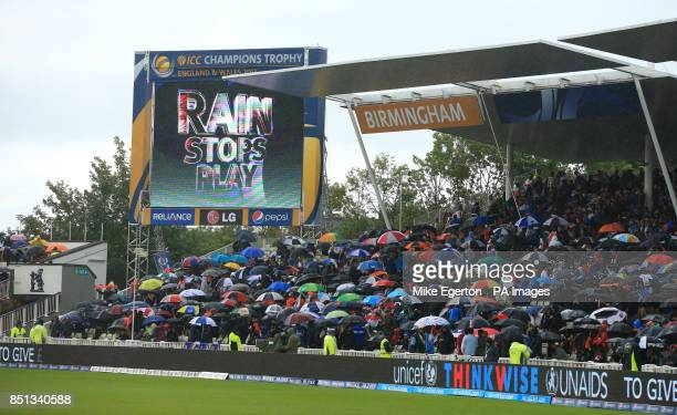 The scoreboard reads Rain Stops Play as the rain falls during the ICC Champions Trophy Final at Edgbaston Birmingham