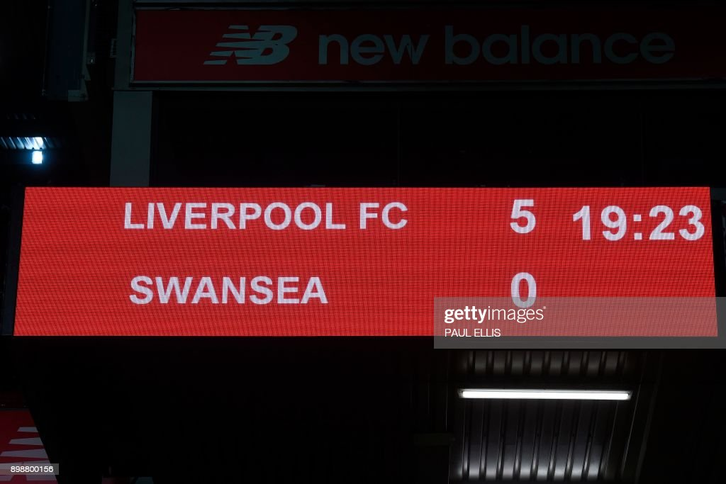 The scoreboard show the final whistle score 5-0 at the end of the English Premier League football match between Liverpool and Swansea City at Anfield in Liverpool, north west England on December 26, 2017. / AFP PHOTO / PAUL ELLIS / RESTRICTED TO EDITORIAL USE. No use with unauthorized audio, video, data, fixture lists, club/league logos or 'live' services. Online in-match use limited to 75 images, no video emulation. No use in betting, games or single club/league/player publications. /